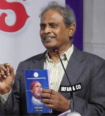 Prof Tirumali